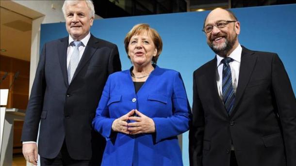 Merkel und Macron hoffen auf Ja der SPD zu Großer Koalition